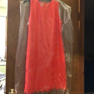 A neon coral lace dress